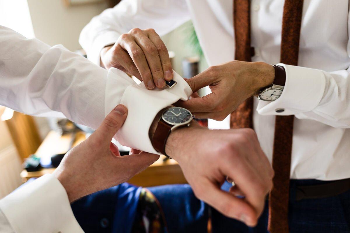 Groomsmen getting ready at documentary wedding