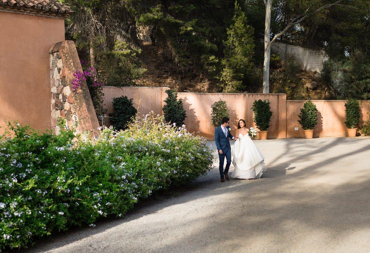 Bride and groom entering Malaga wedding venue