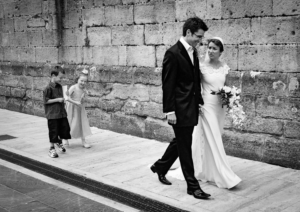 Documentary wedding photography Andalusia Spain / Bride and groom walking down street